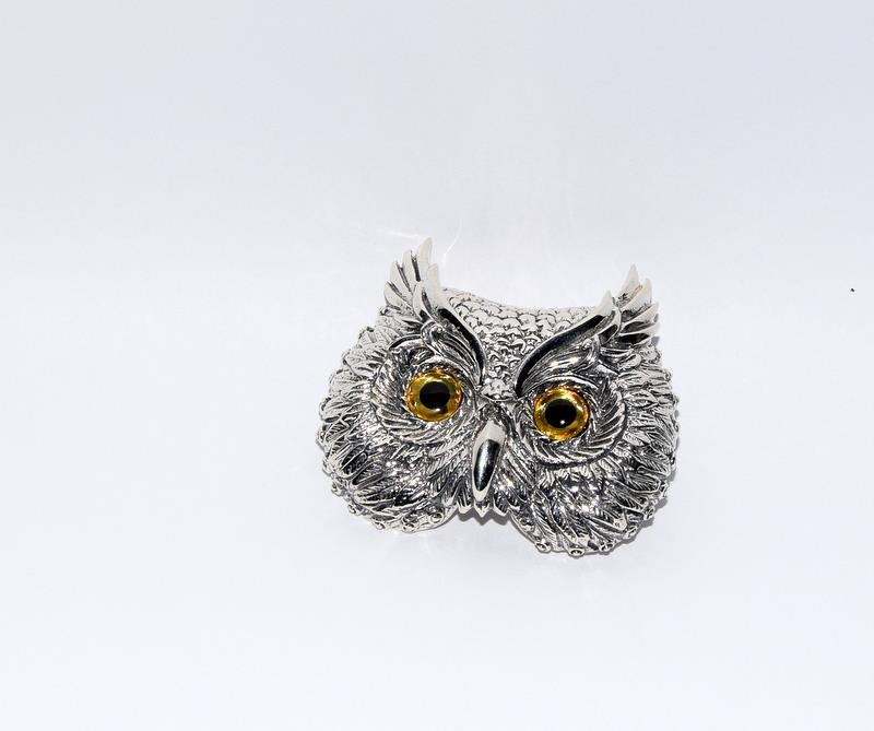 Silver owl brooch with glass eyes.