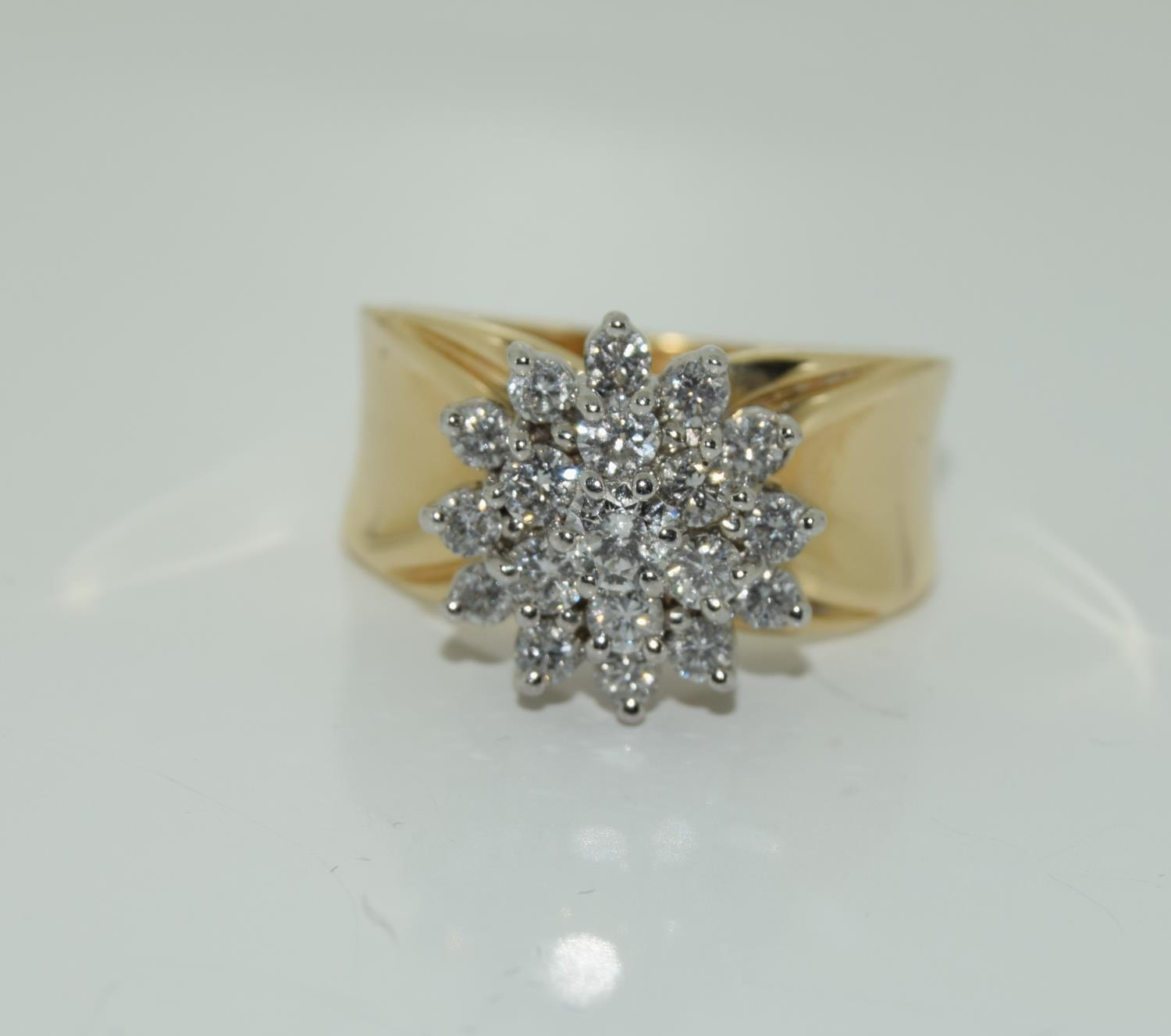 A 14ct yellow gold substantial diamond cluster ring of over 1ct size O