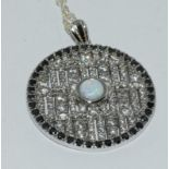 A silver CZ and Sapphire pendant necklace with Opal panels.