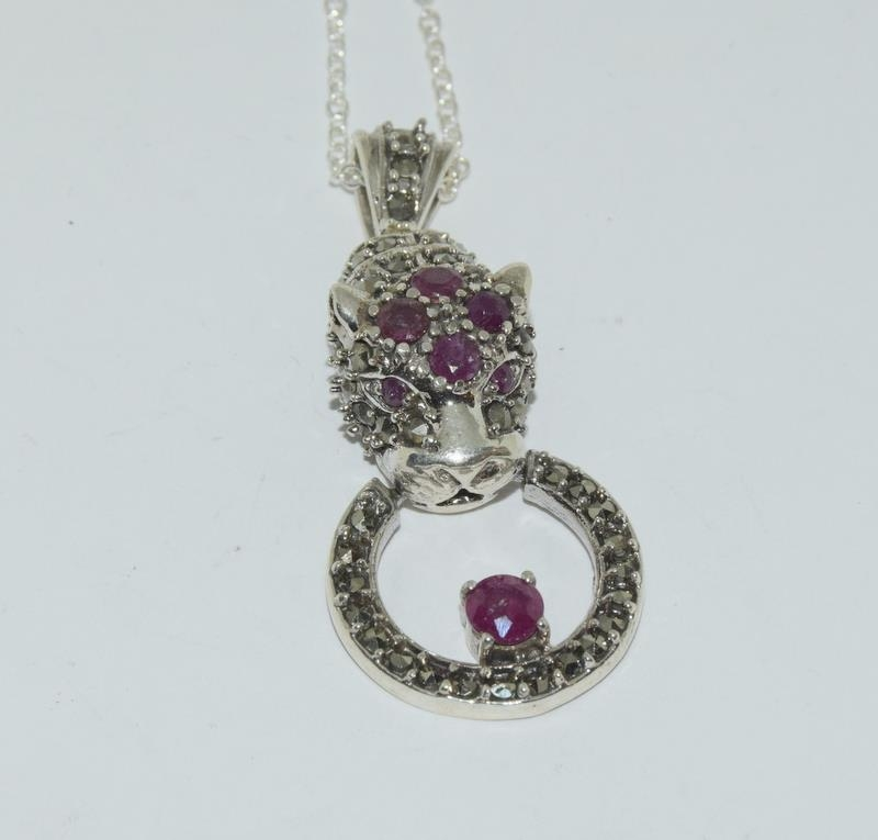 A silver and Ruby set Cartier style Leopard shaped pendant necklace.