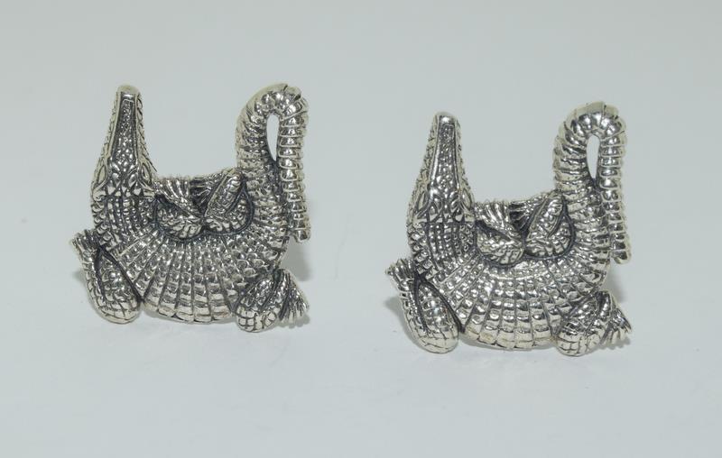A pair of silver Alligator shaped cufflinks.