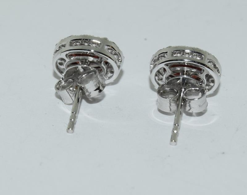 A pair of 18ct white gold garnet and diamond cluster earrings of 2.3cts Approx. - Image 3 of 3