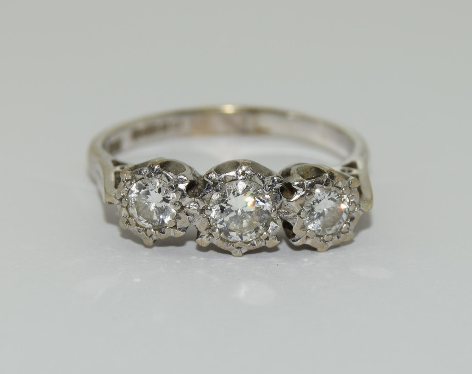 An 18ct white gold ladies three stone diamond ring approx 1ct Size Q.