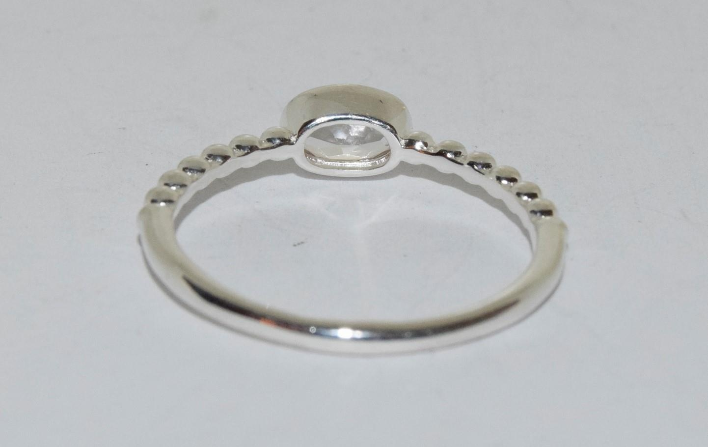 A silver ring with oval stone to centre, Size T 1/2. - Image 3 of 3