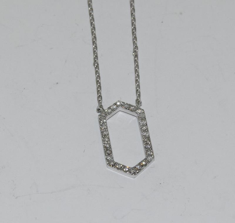An 18ct white gold Diamond set Hexagonal shaped pendant necklace.