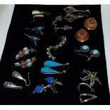 12 sets of silver and other earrings many with turquoise coral and semi precious set stones