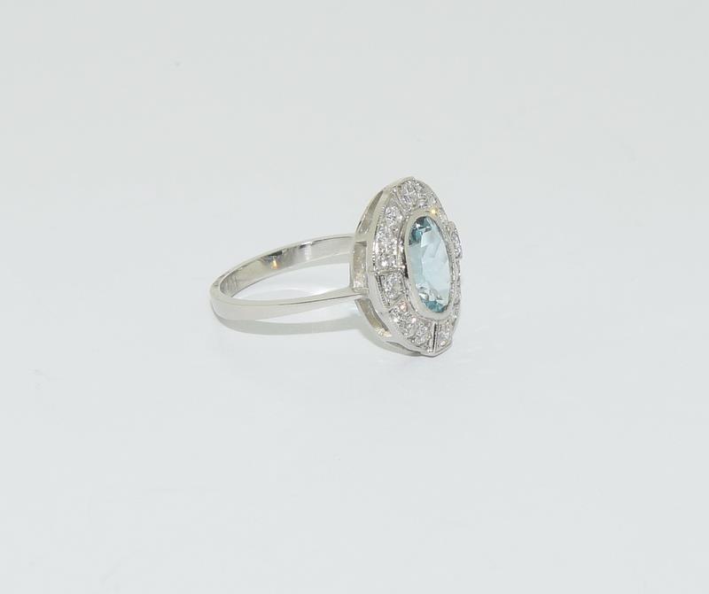 A Platinum aquamarine and diamond ring, Size M - Image 5 of 6