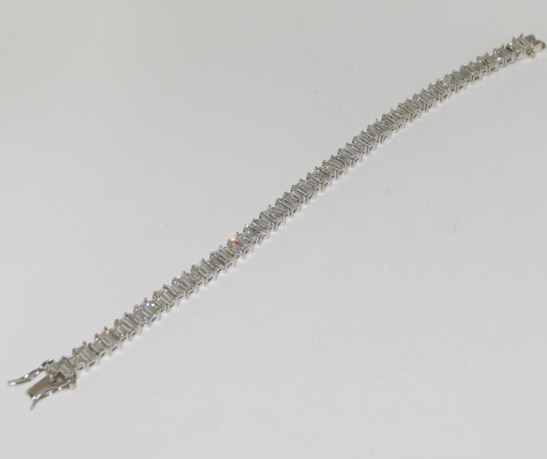 A superb baguette cut CZ 925 Silver line bracelet.