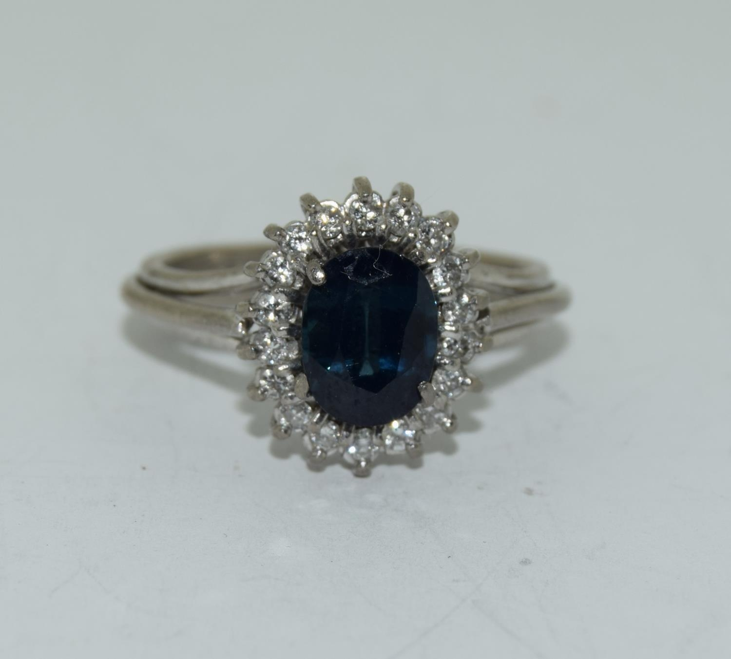 An 18ct white gold ladies diamond and sapphire ring, Size L