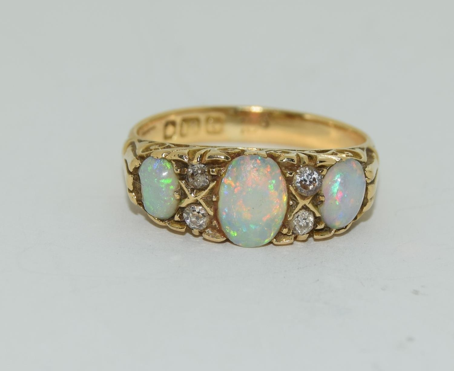 18ct gold ladies 3 stone opal and diamond ring size M