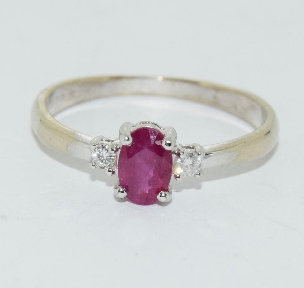 Ruby and Diamond 9ct gold ring, Size O.