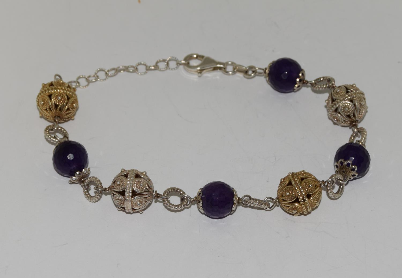 Amethyst ornate gold on silver ball bracelet.