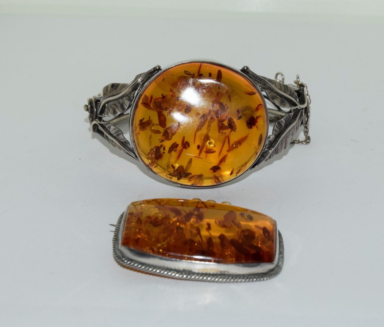 Amber silver set bracelet/brooch.