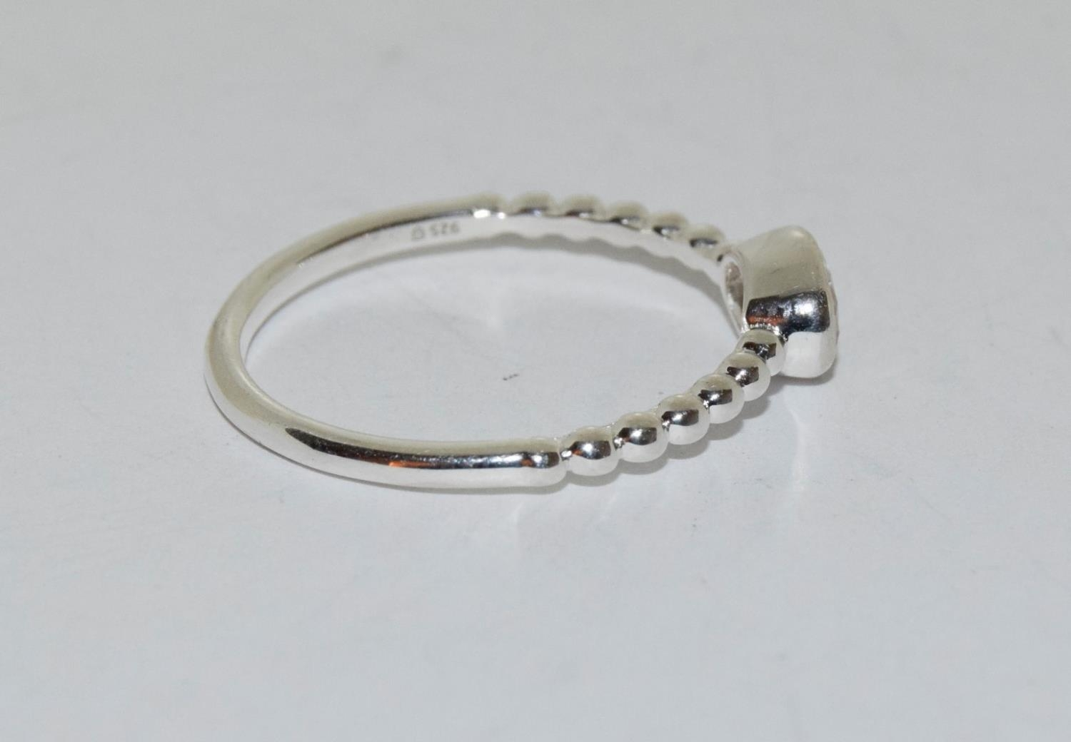 A silver ring with oval stone to centre, Size T 1/2. - Image 2 of 3