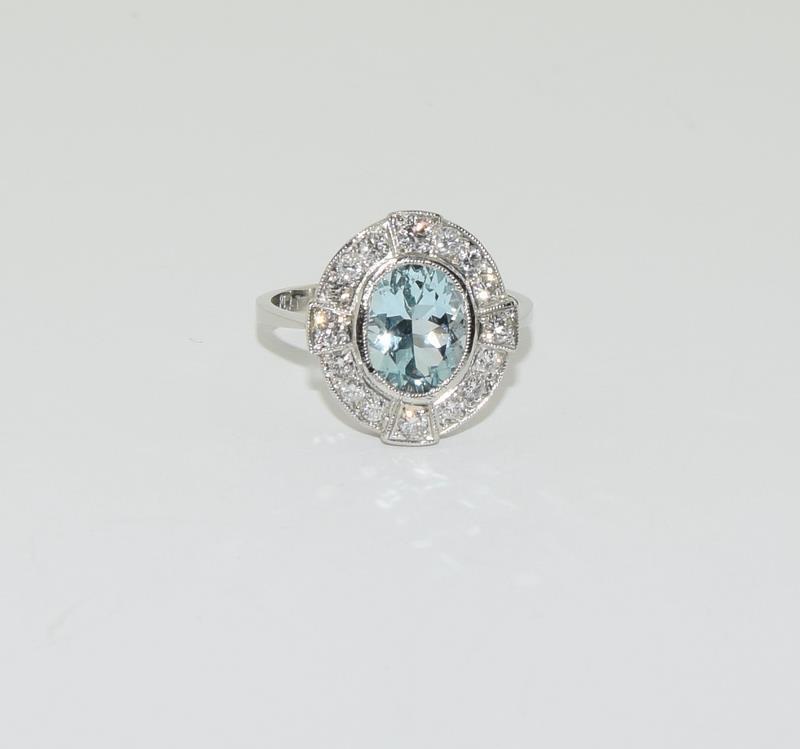 A Platinum aquamarine and diamond ring, Size M