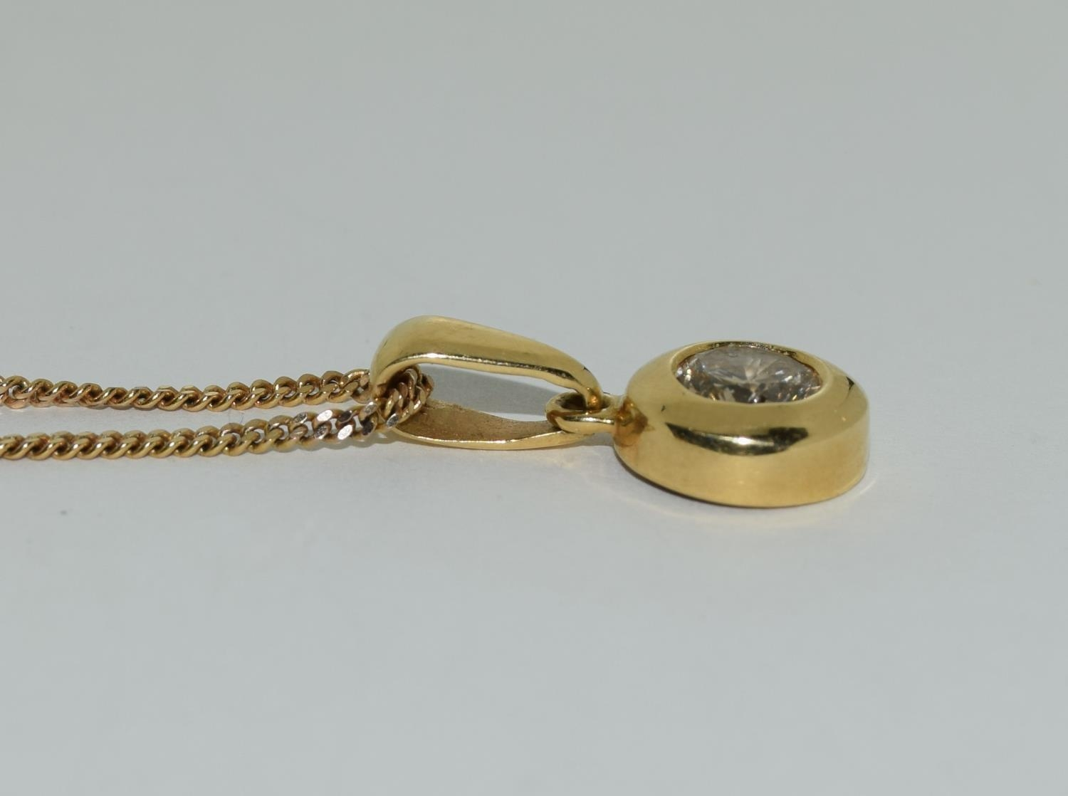 18ct gold diamond pendant of approx 0.6ct on a 9ct gold chain - Image 2 of 4