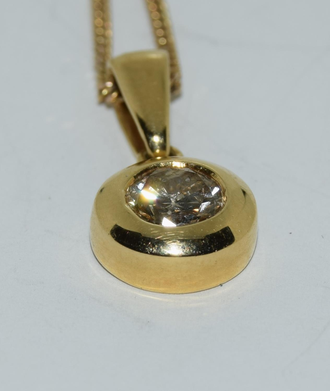 18ct gold diamond pendant of approx 0.6ct on a 9ct gold chain