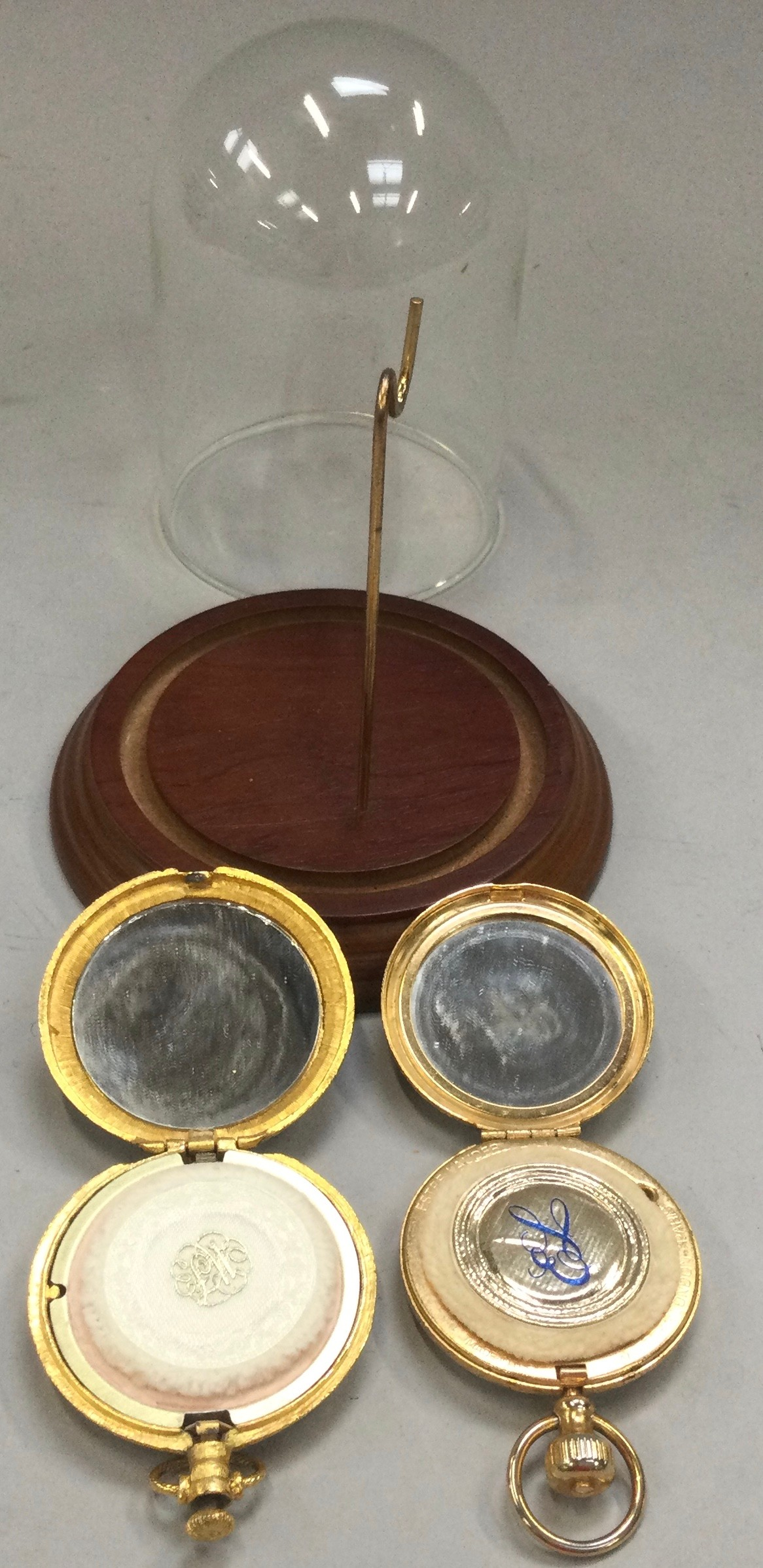 Two novelty ladies powder compacts in the form of pocket watches to include one with dome (2).