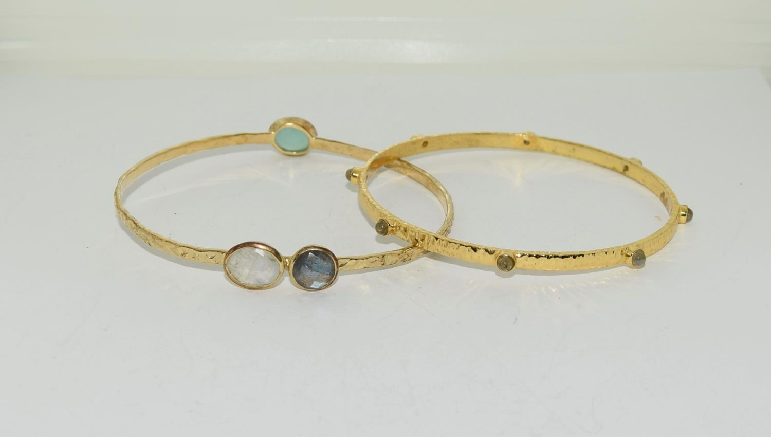 Two moonstone and crysophase gilded bangles.