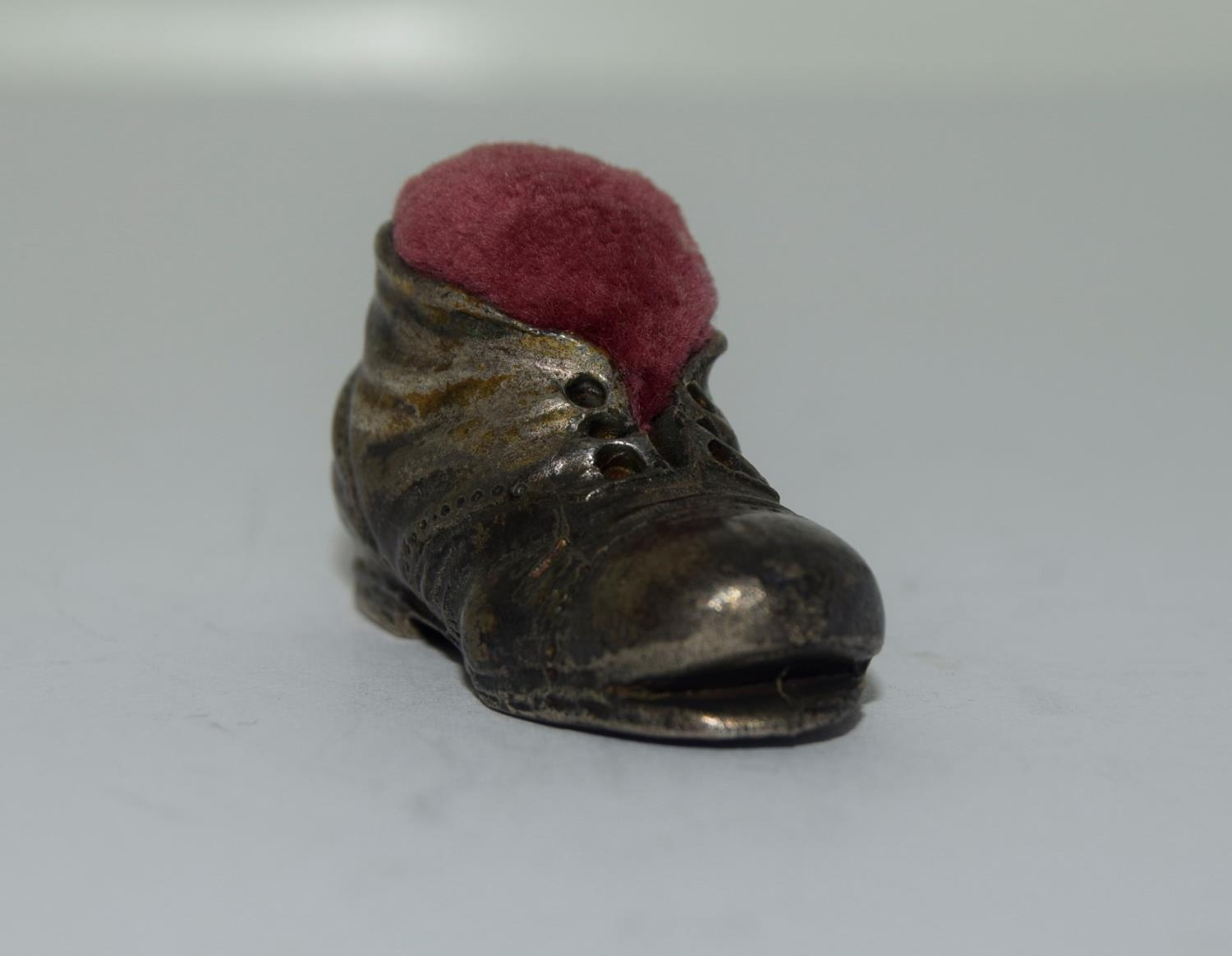 Silver pin cushion in the form of an old boot