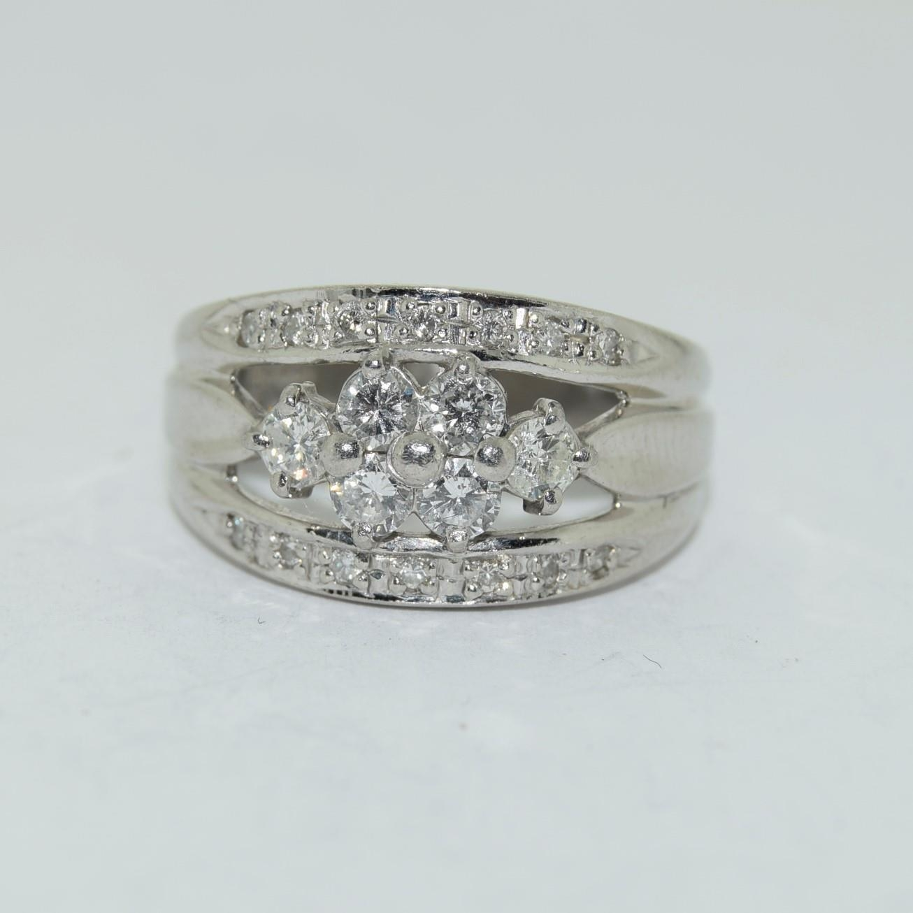 Platinum set ring with central cluster of diamonds approx 70 points size K