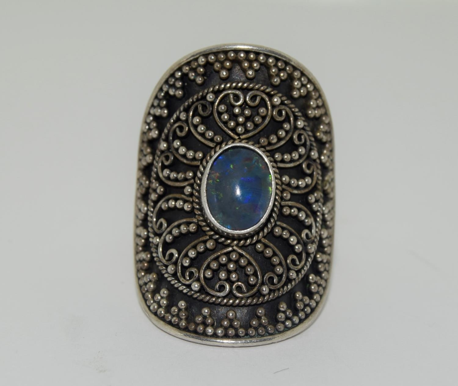 Silver ladies ring with wrap round and opal centre stone size R