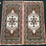 Pair of French ?Tunisia? floor rugs with diamond set pattern 150x75cm each