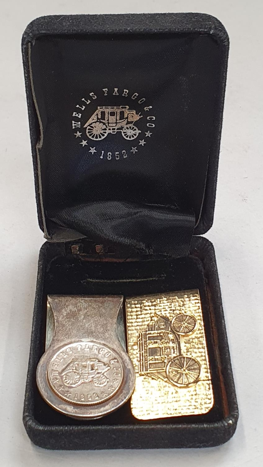 Two boxed Wells Fargo money clips.