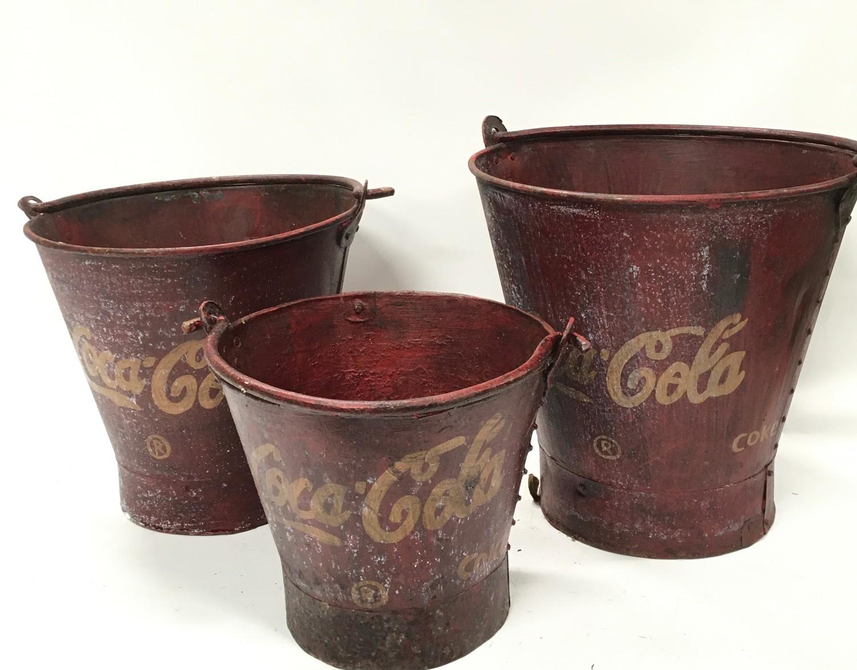 A set of three Coca Cola buckets.(ref 252)