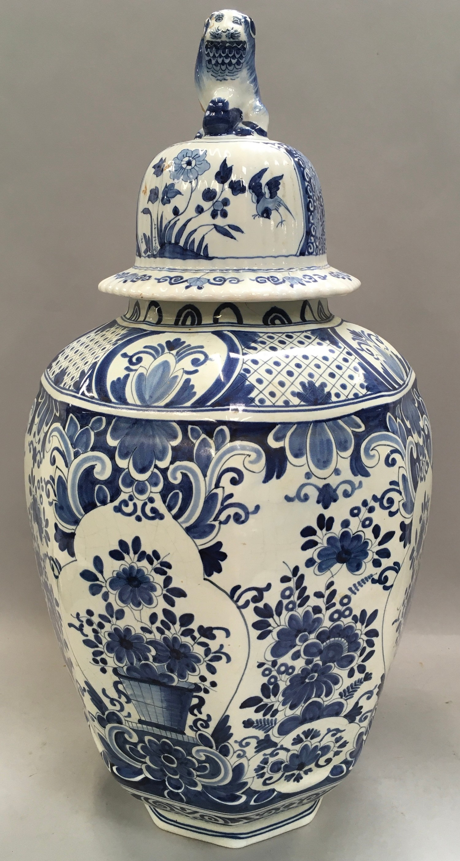 Large blue and white oriental ginger jar with lion finial to the top 53cm tall.