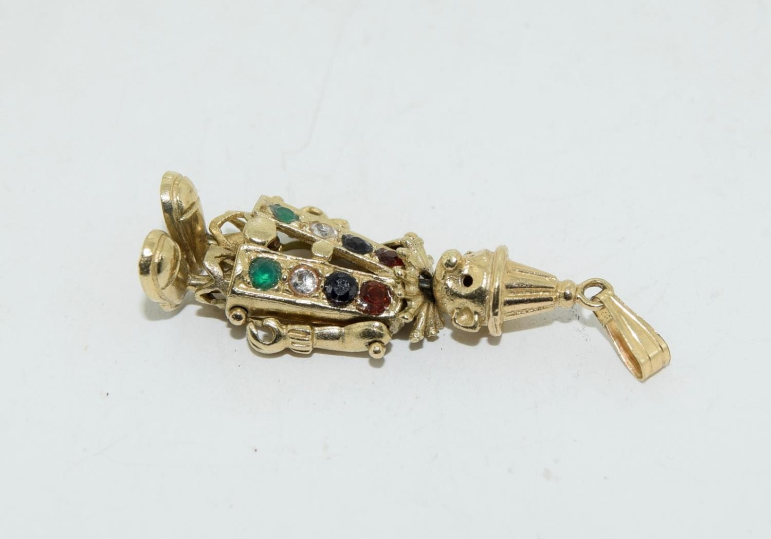9ct gold charm as an articulated clown figure set with precious stone