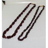 Two garnet gemstone necklaces.