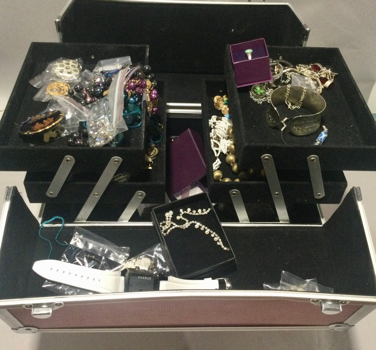 Large carry box with costume jewellery to include silver