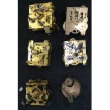 A collection of six assorted clock mechanisms.