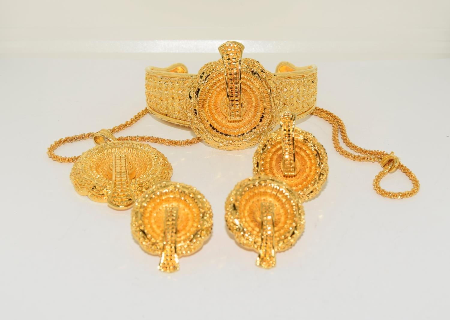Asian 22ct plated suite of jewellery.