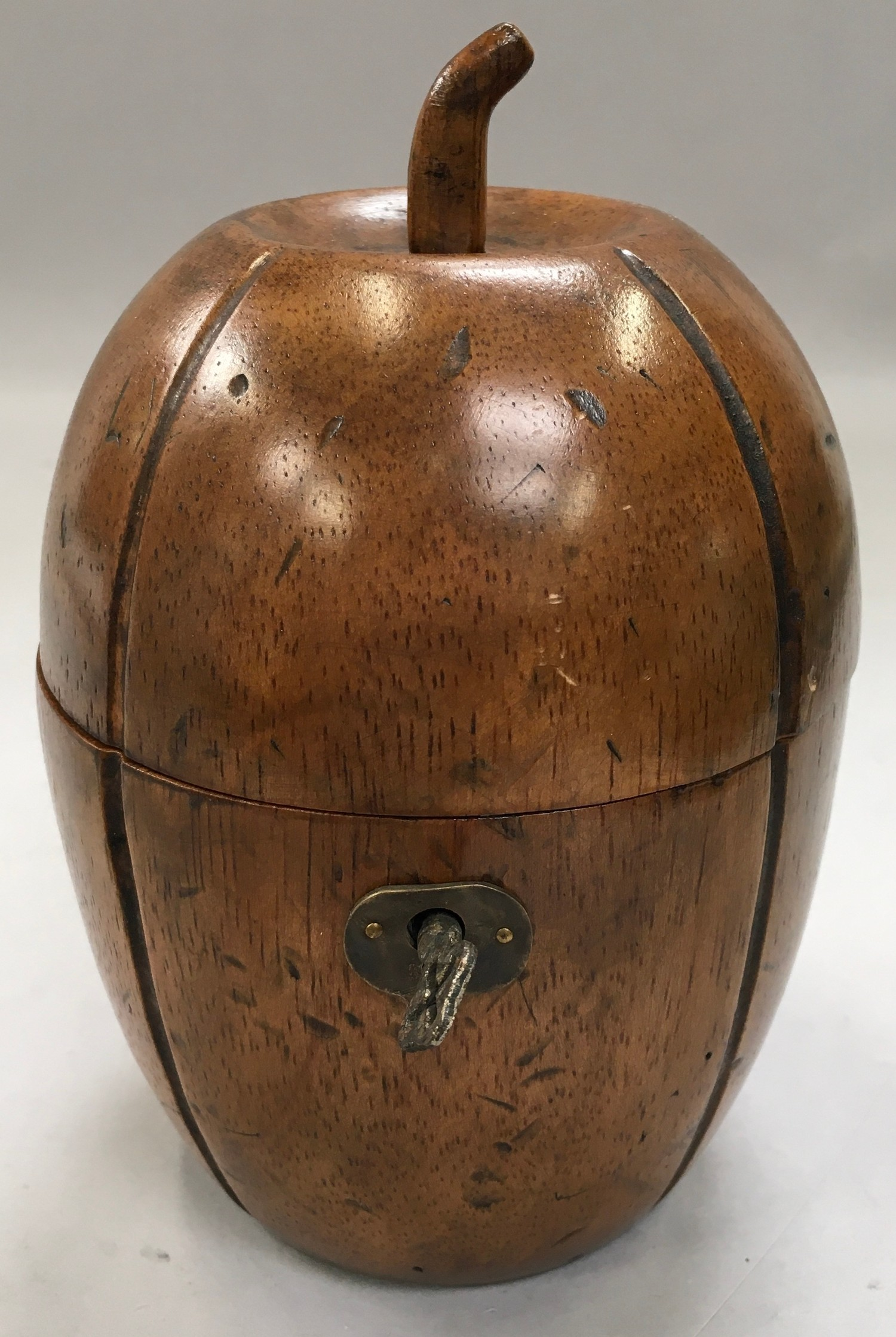 A Georgian style fruit wood tea caddy in the form of a melon with a key