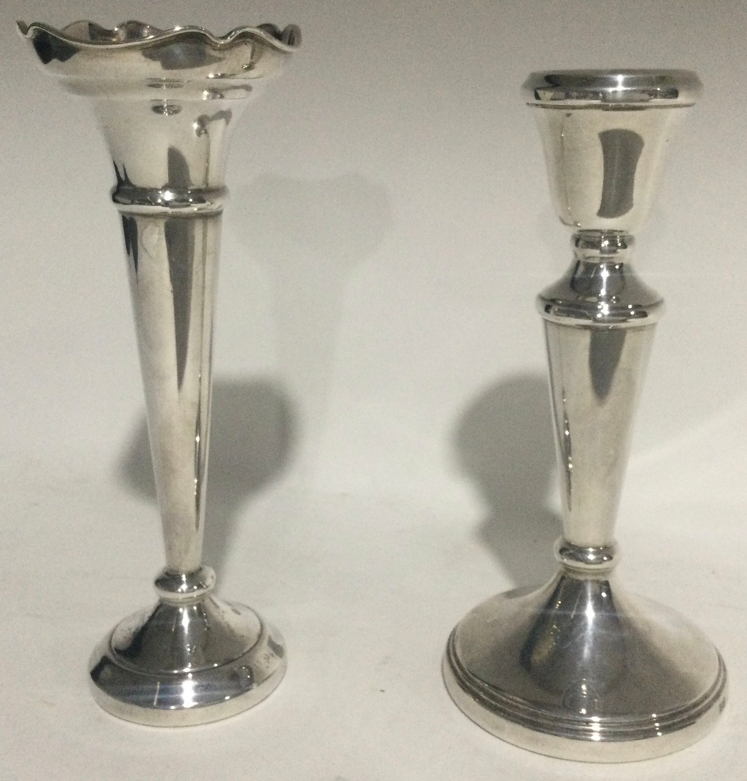 Silver single posy vase together a silver candle stick each 16cm tall