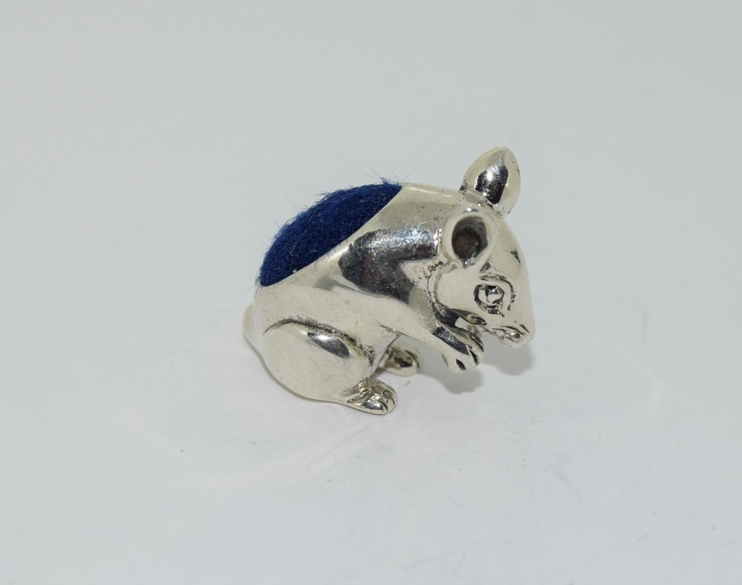 A silver mouse pincushion stamped 925