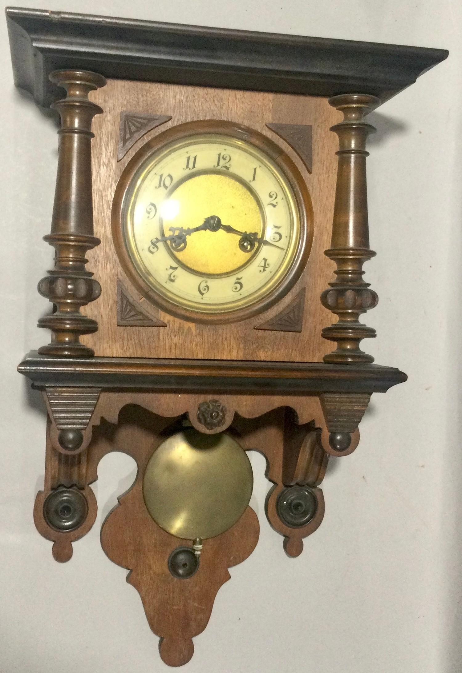 Mahogany striking wall clock with pendulum