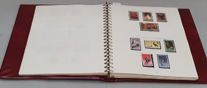 Wine red album of Jersey stamps