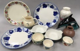 Quantity of Poole Pottery to include large blue and white plates