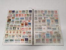 Multi-coloured stamp album for Greece.