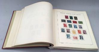 Pink album of Netherland stamps