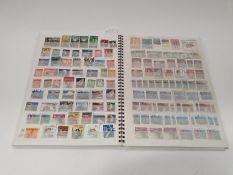 A multi-coloured stamp album 233 New Zealand.