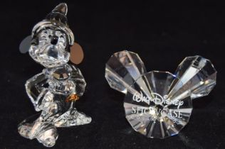 Swarovski Crystal Disney Micky Mouse Sourcer, code 955427, together with Disney Showcase plaque code
