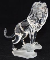 Swarovski Crystal Lion standing on a rock from the Rare Encounters collection, code 269377