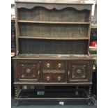 Antique oak two part dresser on barley twist supports 201x151x48cm.