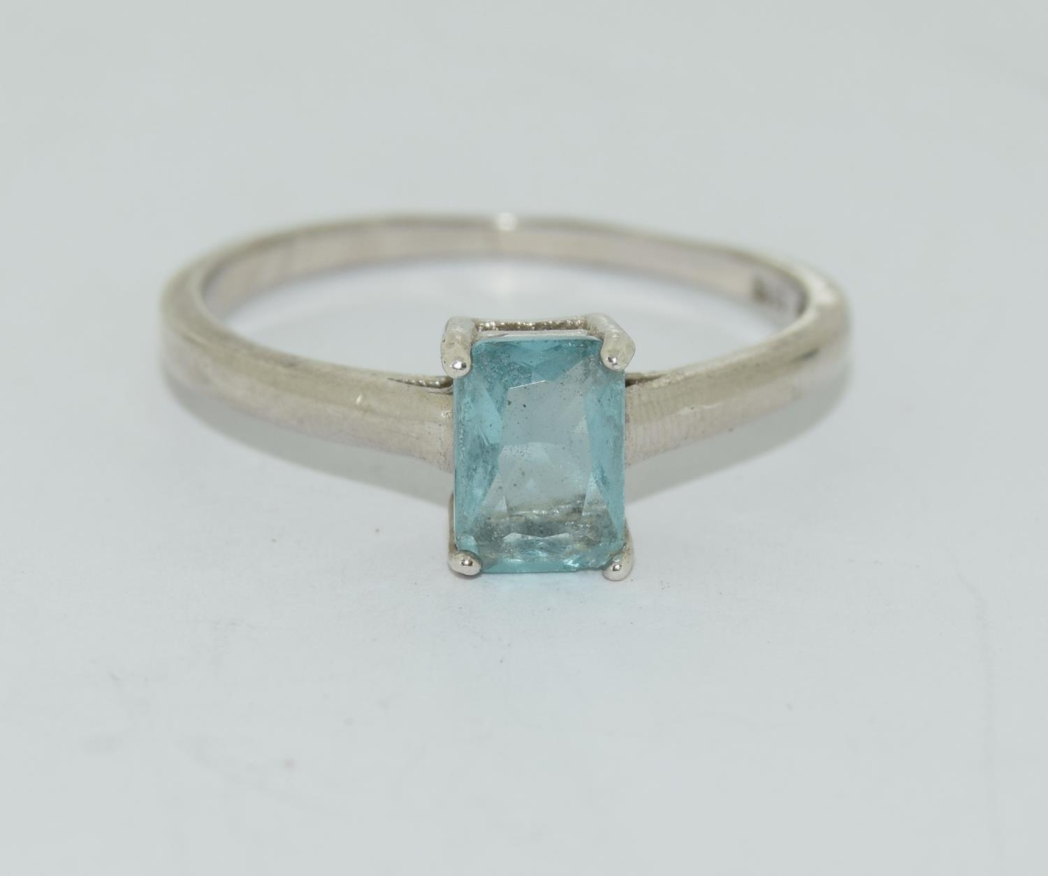 A 925 silver and blue topaz ring. Size R