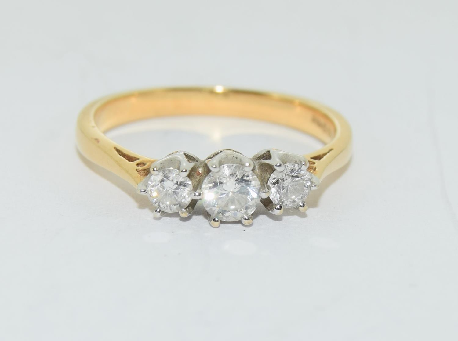 Diamond 3 stone aprox 0.50 points 18ct gold ring size O.