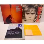 COLLECTION OF U2 ITEMS. Here we have 2 vinyl albums ?War and Under A Blood Red Sky? with a rare ?
